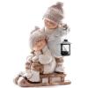 Xecco szánkózó kislány és kisfiú figura 21122